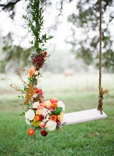 Wooden swing adorned with flowers. --- THANK YOU to the fabulous team behind the shoot: @Matt Nickles Valk Chuah Confetti Committee   @Debbie Arruda Arruda Lofton Photographie   @Gypsy Soul Soul Soul Floral and Events   FEATURED on @Brandon Green Wedding Shoes / Jen Campbell http://greenweddingshoes.com/an-autumn-sunset-bridal-soiree/