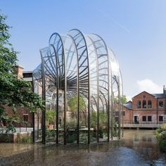 Thomas Heatherwick has completed work on a new complex for gin company Bombay Sapphire in Hampshire, England, including two sculptural glass houses..