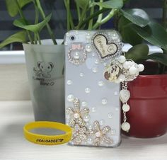 Dealgadgets® 3D Bling Diamond Crystal Rhinestone Pearl Love Heart and Flower Transparent Hard Case Skin Cover for Apple iPhone 5 5G with Free Wristband from Dealgadgets by Dealgadgets, http://www.amazon.com/dp/B009FWQ7QU/ref=cm_sw_r_pi_dp_7lparb0YF4AQ2
