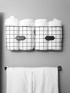 Maybe put shower hooks in the magazine rack/towel storage to hang used towels...