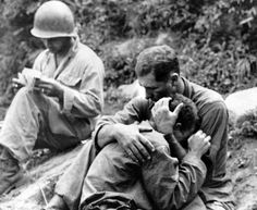An American infantryman being consoled following the death of his buddy, 1950