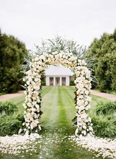 This wedding ceremony floral arch design is seriously stunning! Photo via Tumblr