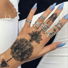 Henna design tattoo, periwinkle color nails, multiple rings