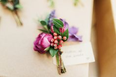 Dark pink, purple & berry autumnal buttonhole - Image by Babb Photo - A London Autumnal wedding at the Londesborough pub in Stoke Newington with a bespoke wedding dress and photography by Babb Photo.