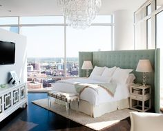 Bedroom layout idea. Green tufted headboard, dark hardwood floors