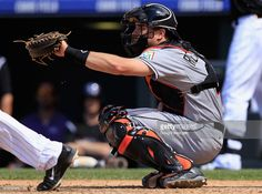 Catcher J.T. Realmuto #20 of the Miami Marlins backs up the plate against the Colorado Rockies at Coors Field on June 7, 2015 in Denver, Colorado.