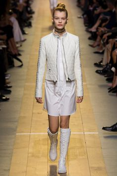 Dior Spring 2017: Model walks the runway in quilted jacket over white shirtdress and lace-up boots