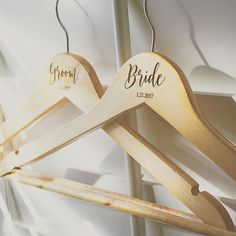 Bride and Groom personalized maple wood hangers. Perfect for a custom gift or wedding photo prop. http://etsy.me/2oI383M