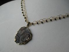 This stunning galaxy stone really stands out against a diamond cut gold filled chain and a smokey quart chain.  This necklace is truly a one of a kind!  Loving all of the original stones that are gaining popularity.