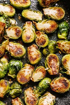 Sauteed Brussel Sprouts - Crispy, buttery, garlicky, and cheesy Brussel Sprouts prepared on the stovetop in just 15 minutes! These deliciously sautéed Brussel Sprouts are an easy and healthy side dish that are quick to make and require only 5 ingredients. Pan Fried Brussel Sprouts, Brussle Sprouts, Cooking Brussel Sprouts, Sprouts With Bacon, Healthy Side Dishes, Vegetable Side Dishes, Sprout Recipes, Sauteed Vegetables, Recipes