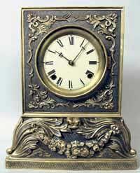 Chauncey Jerome cast metal shelf clock, found in larsonsclocks.com