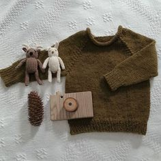Some sweet little handmade things for my baby boy. I loved this knit, and the mossy color of the wool. The wooden camera was made by my husband, and his father. #motherhood…