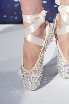 crystal encrusted ballet slippers...Beautiful, but I'll bet that they would be painful to dance in ;)