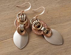 Athena earrings: hammered copper washers, brass, silver scales via Etsy