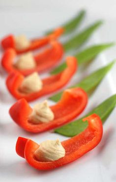 Slices of red pepper with hummus on it.  Would also work with carrot sticks and celery.  Easy party food.