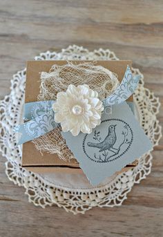 Pretty packaging created by added a doily and flower to a plain brown box #giftwrapping #brownpaper #emballagecadeau