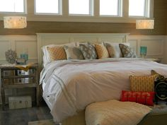 Upholstered Bench at foot of bed, pillows, fluffy comforter