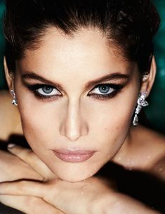 Piercing eyes + perfect earpieces. Laetitia Casta by Mario Testino for Vogue Paris May 2012
