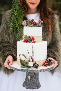 Your wedding cake will exude winter with natural pine cone toppers. It definitely brings the outside in! | See more seasonal symbols for winter weddings here: http://www.mywedding.com/articles/winter-wedding-ideas-pick-a-seasonal-symbol/