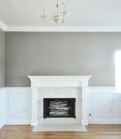rockport gray walls and logs in fireplace