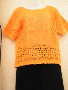 polera naranja tejida por Marcia Vasquez