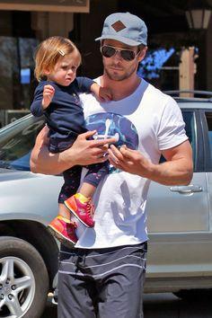 Chris Hemsworth holding daughter India Rose.  -Cosmopolitan.com