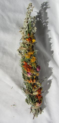 Beautiful smudge stick - white sage, cedar, juniper, lavender, rose, and wildflowers. $8.95, via Etsy.