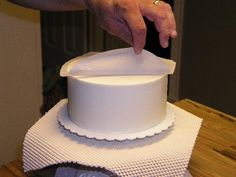 Perfectly smooth butter cream with a sharp edge. I can't wait to try it!!! I'm so hopeful... I usually use the viva paper towel method, but it leaves a rounded corner. Sometimes I want a sharp edge but had no idea how to do it... Hope this works as well as people are saying...