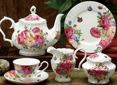 What could be more beautiful than a combination of butterflies and colorful rose blooms?  This Bone China tea set features both on a white background with gold trim.  A radiant pattern indeed, filled with the colors of a Summer garden, this tea set has bold styling to suit the most discerning of tastes.    The set includes: One 6 cup Teapot / 4 Cups/Saucers / 4 Dessert Plates / 1 Creamer/Sugar  Additional pieces in this pattern are also available below.