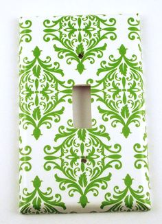 Cute way to amp up home decor or tie in some patterns, simply mod podge matching fabric or scrapbook paper onto a 25 cent light switch or outlet cover.   -af