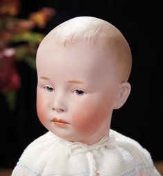 """German Bisque Pouting Character, 7602, by Gebruder Heubach ---15""""Marks: Heubach (sunburst) 7 Germany 7602. Comments: Gebruder Heubach, circa 1912. Value Points: very fine quality of sculpting depicting a wistful-faced child."""
