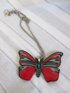 SOLD Hand Painted Black and Red Moth Pendant on Silver Chain, Tyria Jacobaeae, Cinnabar by DeadPoetAccessories on Etsy