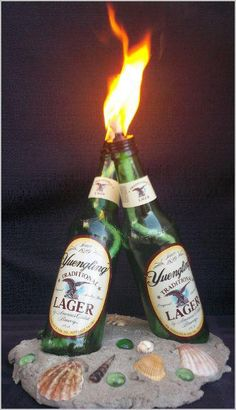 Diy corona tiki torches man would i waste a lot of beer for Diy beer bottle tiki torches