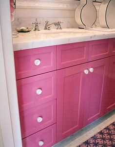 The vanity was a nondescript, off-the-shelf white cabinet with a Carrara marble top. To dress it up, Benjamin Moore's Pink Ladies in high-gloss finish. Marble floor