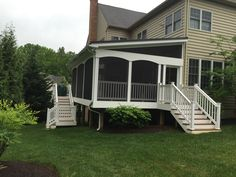 Custom arched Fascia Boards, porch cladded in white vinyl