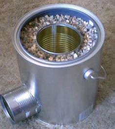 Homemade TIN CAN Rocket Stove - DIY Rocket Stove - Awesome Stove! Homemade TIN CAN ROCKET STOVE. no special tools required. This stove is great! Items needed: 3 metal cans, gravelsand andor dirt! Add copper spiral pipe against (or in?) central can to crea