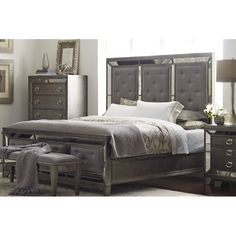 Refresh your master suite or guest room in regal style with this statement-making bed, showcasing mirrored panels and silver nailhead trim.