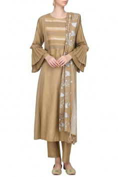 Devnaagri Featuring a brown kurta in cotton silk base embellished with patra and pleated frills on the sleeves. It is paired with pants with silver zari lines on the bottom and double layered block printed dupatta. Kurti Sleeves Design, Pernia Pop Up Shop, Sleeve Designs, Cotton Silk, Designer Wear, No Frills, Fashion Dresses, Cold Shoulder Dress, Brown