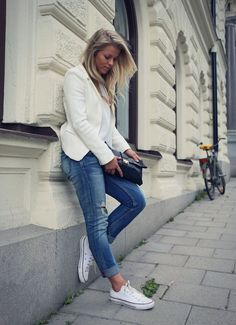 an all white look with blue distressed jeans and Converse for late summer