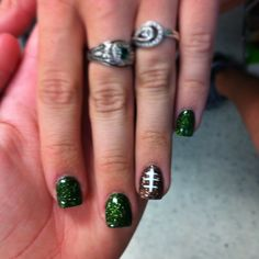 Football nails... maybe with black or blue nails for the Carolina Panthers?