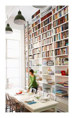 I want to live here! Huge ceilings, floor to ceiling bookshelves and a library ladder, can't get better!