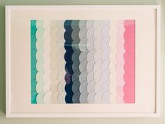 After amassing a variety of paint swatches from your home makeover, organize them into groups by color. Here, a gradient effect was created by lining up the colors and differentiating them by levels of saturation. For a cohesive look, consider cutting all swatches into the same shape using craft scissors. Attach the swatches to poster board using double-sided tape, and then add matting before placing into a frame.