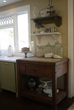 White/Green Kitchen.  Love the old table.