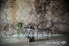 One World interiors - Havana Lounge chair  & concrete side tables - Picture: Paulina Arcklin