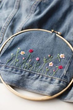 diy clothes Fabulous DIY embellished jean jacket for a unique, personalized back to school wardrobe staple. A combo of applique patches + hand embroidery make it custom Hand Embroidery Stitches, Ribbon Embroidery, Embroidery Art, Cross Stitch Embroidery, Simple Embroidery, Denim Jacket Embroidery, Embroidered Denim Jacket, Embroidery Patches, Hand Embroidery Designs