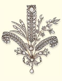 AN CENTURY PRINCE OF WALES FEATHER BROOCH. The three rose-cut diamond feathers to the diamond-set floral branches and diamond bow, set en tremblant, mounted in silver and gold, circa cm. high, in fitted case. Edwardian Jewelry, Antique Jewelry, Vintage Jewelry, Diamond Bows, Rose Cut Diamond, Royal Jewels, Crown Jewels, Art Nouveau, Art Deco