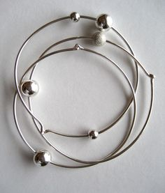 Apa Design Sterling Silver Atomic Orbit Bangles...I have gotten SOOO many compliments on these!