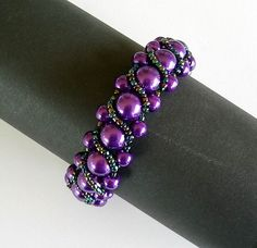 Beaded Bracelet Purple Glass Pearls and Black AB Glass Seed Beads Flat Spiral Stitch on Etsy, $23.00