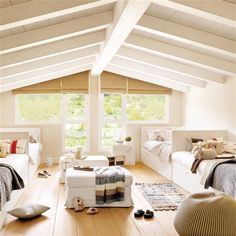 classic cottage.  back to back beds against long walls, pitched ceilings with exposed beams, and beautiful natural light.