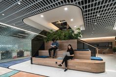 Designed by Woods Bagot, Dentsu Aegis Network's new Beijing workplace has a central staircase that supports the company's philosophy.